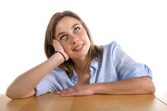 Young woman lost in thought. On the white background Royalty Free Stock Photo