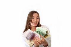Young woman with a lot of money Royalty Free Stock Photo