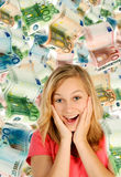 Young woman and a lot of money Royalty Free Stock Image