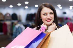 Young woman with a lot of shopping bags Stock Photos