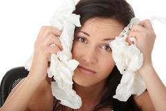 Young woman in lot of tissues around Royalty Free Stock Image