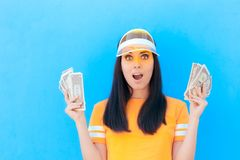 Cute Girl Holding Her Money Savings in Dollar Banknotes. Young woman with lots of cash planning financial future royalty free stock image