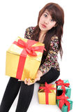 Young woman with lots of gifts Royalty Free Stock Photo