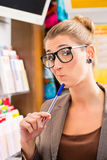 Young woman in Lotto shop playing ticket Royalty Free Stock Image