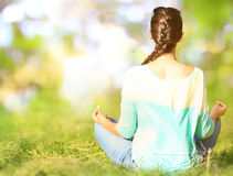 Young woman in a lotus position Royalty Free Stock Photo