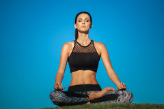Young woman in lotus position Royalty Free Stock Photography