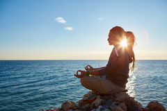 Young woman in the lotus position Royalty Free Stock Photo