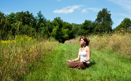 Young woman in lotus position meditating Stock Photo