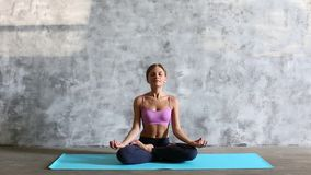 Young woman in a lotus position. stock video
