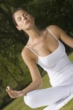 A young woman in a lotus position Royalty Free Stock Photo