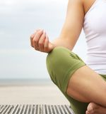 Young woman in lotus position with yoga hands Royalty Free Stock Photos