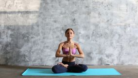Young woman in a lotus position. stock footage