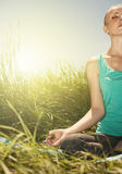 Young woman in the lotus posture close up nature photo Royalty Free Stock Photo