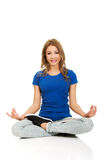 Young woman in lotus yoga pose. Royalty Free Stock Photography