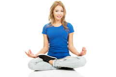 Young woman in lotus yoga pose. Royalty Free Stock Images