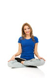 Young woman in lotus yoga pose. Stock Photos