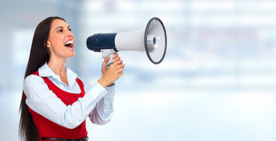 Young woman with loudspeaker. Royalty Free Stock Photo