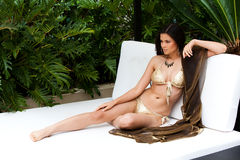 Young Woman Lounging in a Designer Bikini Stock Photography