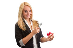 Young woman with loupe and present Royalty Free Stock Image