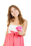 Young woman in love holding rose daydreaming Royalty Free Stock Image