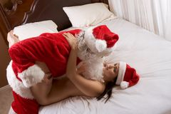 Young woman in love with Santa Claus Stock Image