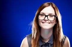 Young woman with lovely smile and nerd glasses Stock Photography