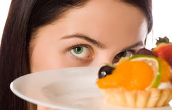 Young woman with low-calorie fruit cake. (focus on face stock photos