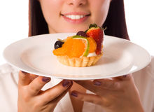 Young woman with low-calorie fruit cake. (focus on cake stock photos