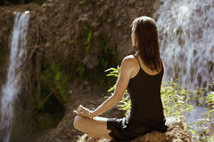 Sitting in meditation Stock Images