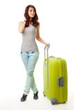 Young woman with luggage Royalty Free Stock Images