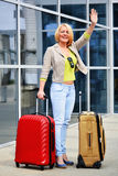 Young woman with luggage at the airport. Traveling tourist Royalty Free Stock Photo