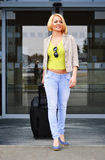 Young woman with luggage at the airport. Traveling tourist Royalty Free Stock Photography