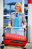 Young woman with luggage at the airport. Traveling tourist Stock Images