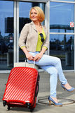 Young woman with luggage at the airport. Traveling tourist Stock Image