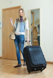 Young woman with luggage Royalty Free Stock Photos
