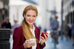 Young woman on lunch break Royalty Free Stock Image