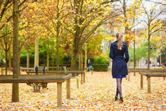 Young woman in the Luxembourg garden of Paris on a fall day. Beautiful young woman in the Luxembourg garden of Paris on a fall day stock photography