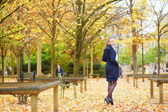 Young woman in the Luxembourg garden of Paris on a fall day. Beautiful young woman in the Luxembourg garden of Paris on a fall day stock images