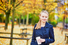 Young woman in the Luxembourg garden of Paris on a fall day. Beautiful young woman in the Luxembourg garden of Paris on a fall day, drinking coffee to go stock photos