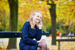 Young woman in the Luxembourg garden of Paris on a fall day. Beautiful young woman in the Luxembourg garden of Paris on a fall day, drinking coffee to go and stock images