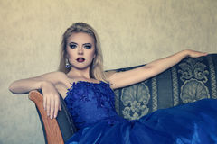 Young woman in luxurious blue dress Stock Photos