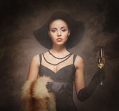 A young woman in luxurious clothes with champagne Royalty Free Stock Photography