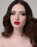 Young woman with luxurious dark hair and evening makeup Royalty Free Stock Images