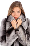Young woman in luxury fur coat. Isolated on white background Stock Images