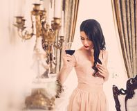 Young woman in luxury house interior Stock Photo
