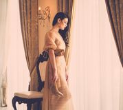 Young woman in luxury house interior Royalty Free Stock Image