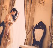 Young woman in luxury house interior Stock Images