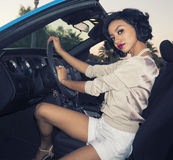 Young woman in luxury sports car royalty free stock photo