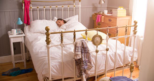 Young Woman Lying Asleep In Untidy  Bedroom Royalty Free Stock Photography
