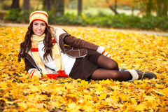Young woman lying in autumn leaves Royalty Free Stock Photo